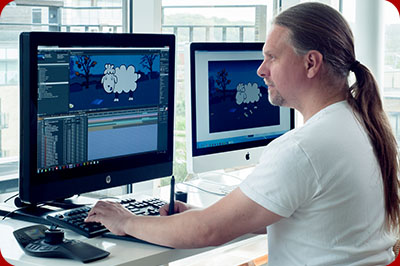 Adobe After Effects designer, Simon Kotowicz, sits at a graphics workstation to work on an animation.